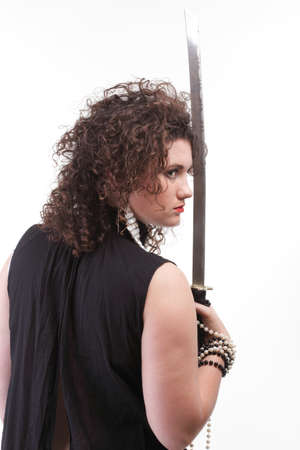 Girl - woman dark curly hair natural brown-haired holding hands katana sword Stock Photo - 13382501