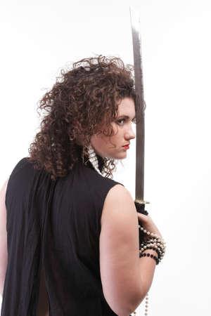 Girl - woman dark curly hair natural brown-haired holding hands katana sword Stock Photo - 13382501