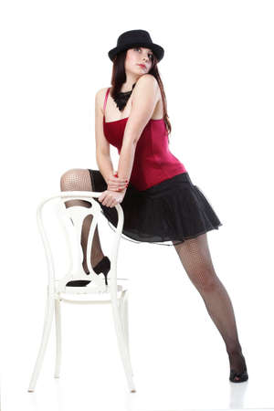 entertainment pastime girl dance in red corset chair white isolated showgirl, photo