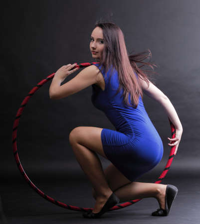 Beautiful woman in a sport wear. Dance hoop gym exercises black background Stock Photo - 13389427