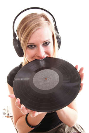 Woman with headphones listening to music - isolated over a white background analogue record photo