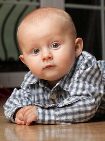 portrait of 6 months boy, male child sitting on floor Stock Photo - 13552115