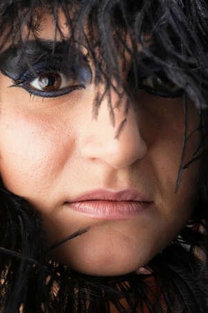 Beautiful Portrait of woman. Studio shot. Professional make up and hair style black feather Stock Photo - 13577835