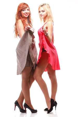 variance: Two pretty women in red and brown gowns, ginger with blonde isolated on white Stock Photo
