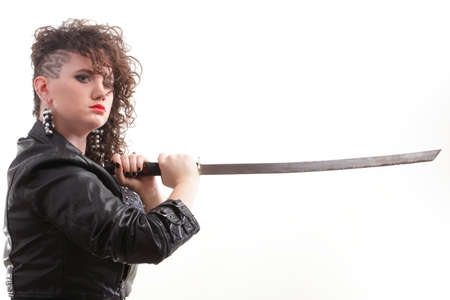 Girl - Ear super piercing woman dark hair natural brown-haired holding in her hands a katana Stock Photo - 13552107