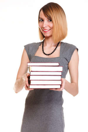 Beautiful young woman with red books isolated on a white background photo