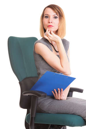 young business woman sitting with her clipboard isolated on white background photo