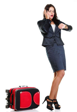 Full length of young business woman to late pulling red travel bag clock isolated on white background Stock Photo - 13570641