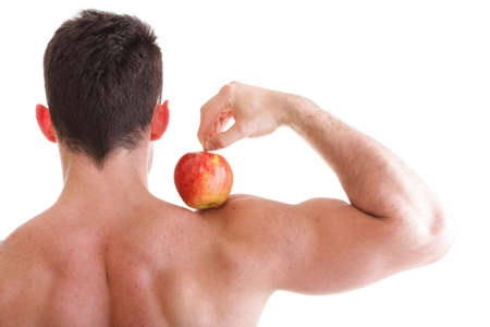 Red Apple on Man Bicep Muscle isolated on white. Athletic sexy male body builder holding Stock Photo - 13544192