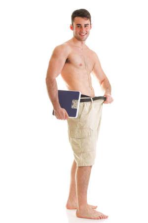 Cuerpo musculoso hombre y la escala aisladas sobre fondo blanco Foto de archivo