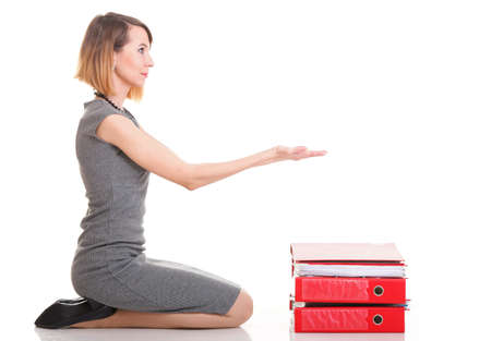 woman Overworked businesswoman holding plenty of documents isolated white red folder Stock Photo - 13644111