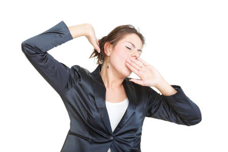 portrait of beautiful tired business woman stretching and yawning at her workplace isolated on white 写真素材