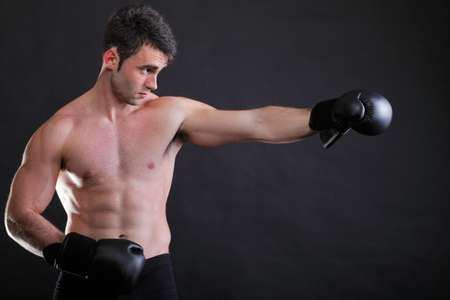 Portrait sportsman boxer in studio against dark background Stock Photo