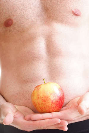 Muscle sexy wet naked young man torso and red apple in hands diet Stock Photo - 13657297