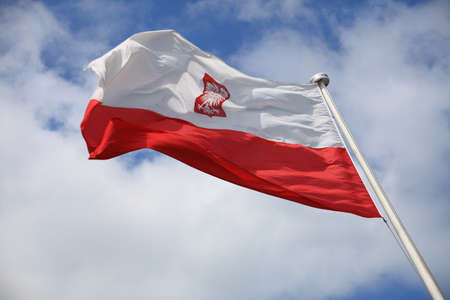 Flag of Poland on blue sky outdoor Stock Photo - 13753937