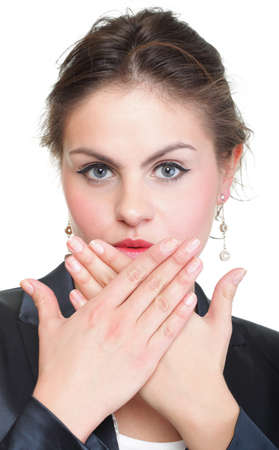 portrait of excited business woman covering her mouth by the hand, over white background photo