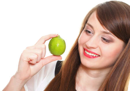 Young smiling woman with fruits and vegetables. Over white background Stock Photo - 13808416