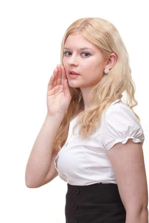 Business woman eavesdropping with hand behind her ear photo