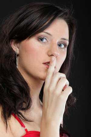 Young girl asking for silence beautiful woman with finger on her lips - copyspace Stock Photo - 13799277