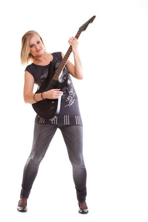 Woman with black guitar looking at you isolated on white photo