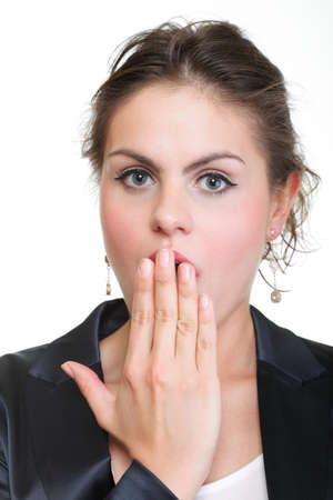 portrait of excited business woman covering her mouth by the hand, over white background Stock Photo - 13799255
