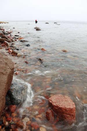Fisherman Stones in sea water autumn in Orlowo, Gdynia Poland Stock Photo - 13822588