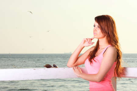 Attractive girl on pier Young woman on background of sea Stock Photo - 13852732