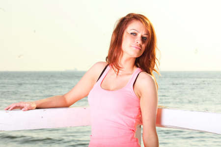 Attractive girl on pier winter in hair Young woman on background of sea sky Stock Photo - 13852723
