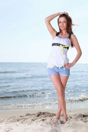 The young happy woman on a beach sea and sky vacation Stock Photo - 13852681