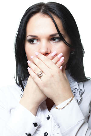 discreet: discreet awkward meaningful silence pretty woman with hands over mouth Stock Photo