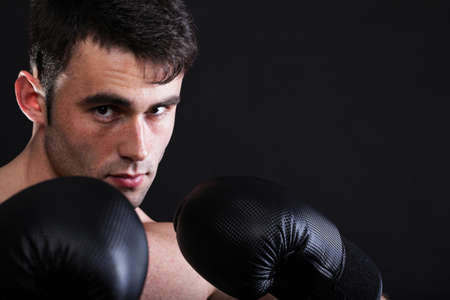Portrait sportsman boxer in studio against dark background 写真素材