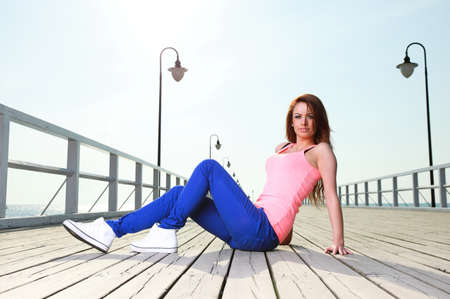 Attractive girl Young woman on pier Sits Relaxing Old Wooden Pier Stock Photo - 14065222