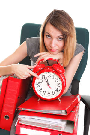 stoppage: woman Overworked businesswoman holding plenty of documents isolated white red folder timeer time Stock Photo
