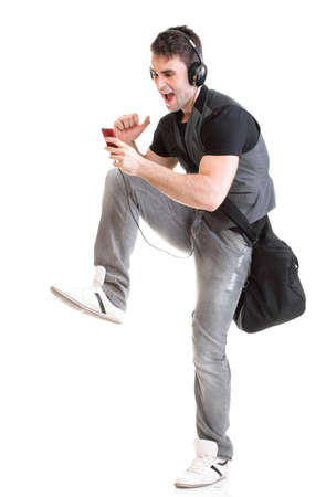 Full length portrait school boy phone isolated on white running while listening to music 写真素材