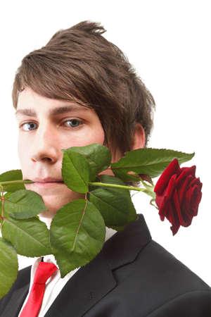Junger stattlicher Mann mit Blume, <b>rote Rose</b> isoliert weißem Hintergrund - 14218973-junger-stattlicher-mann-mit-blume-rote-rose-isoliert-weissem-hintergrund