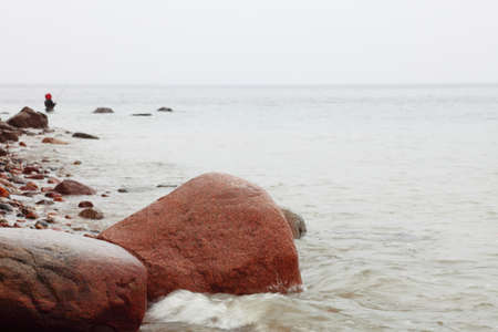 Fisherman Stones in sea water autumn sea in Orlowo, Gdynia Poland Stock Photo - 14215168