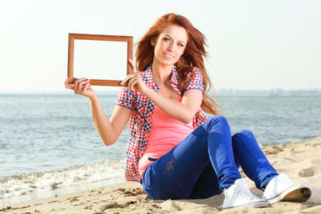 Woman sea sky vacation Holding Frame travel concept photo