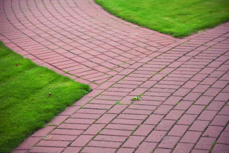 redbrick: Garden stone path with grass growing up between and around stones, Brick Sidewalk