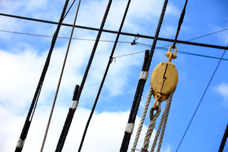 Masts and rope of sailing ship old boat detail photo