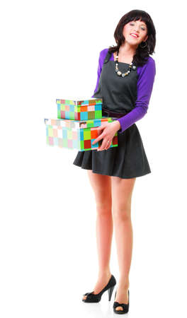 Woman carrying moving boxes. Young woman moving house to new home holding cardboard boxes isolated on white background standing in full length photo