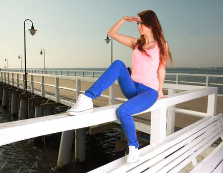 Attractive girl Young woman looking on background of sea sky Stock Photo - 15043277