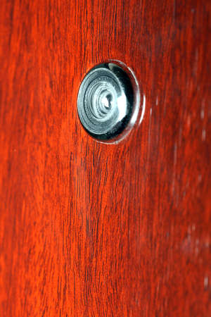 peephole: Peephole on wooden door - judas hole spyhole