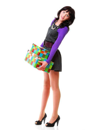 Woman carrying moving boxes.   photo