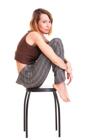 worried and afraid young woman sitting on chair. Isolated on white Stock Photo - 15479467