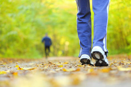 Woman walking cross country and trail in autumn forest Stock Photo - 15739819