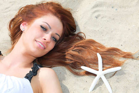 The beautiful girl lies on sea coast with shells nature vacation woman photo
