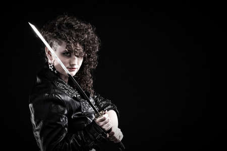 Girl - Ear super piercing woman dark hair natural brown-haired holding hands katana sword Stock Photo - 15870736