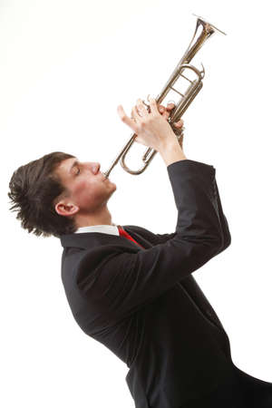 Portrait of a young jazz man playing his Trumpet white background photo