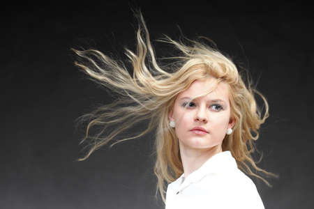 Blonde woman with her hair blowing in the wind Stock Photo - 16237669