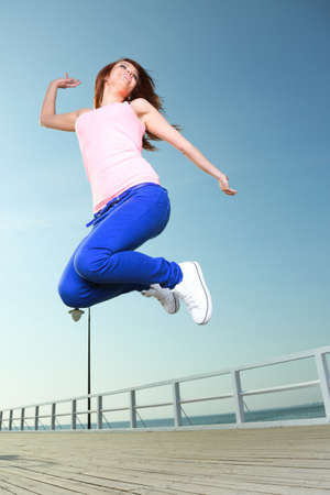 Attractive girl Young woman jumping in the sky Stock Photo - 16237665